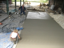 Adele laying concrete in new cow shed - Ian assisting